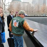 Volunteer Dan, along with teachers and students. paying their respects at the 9/11 Memorial